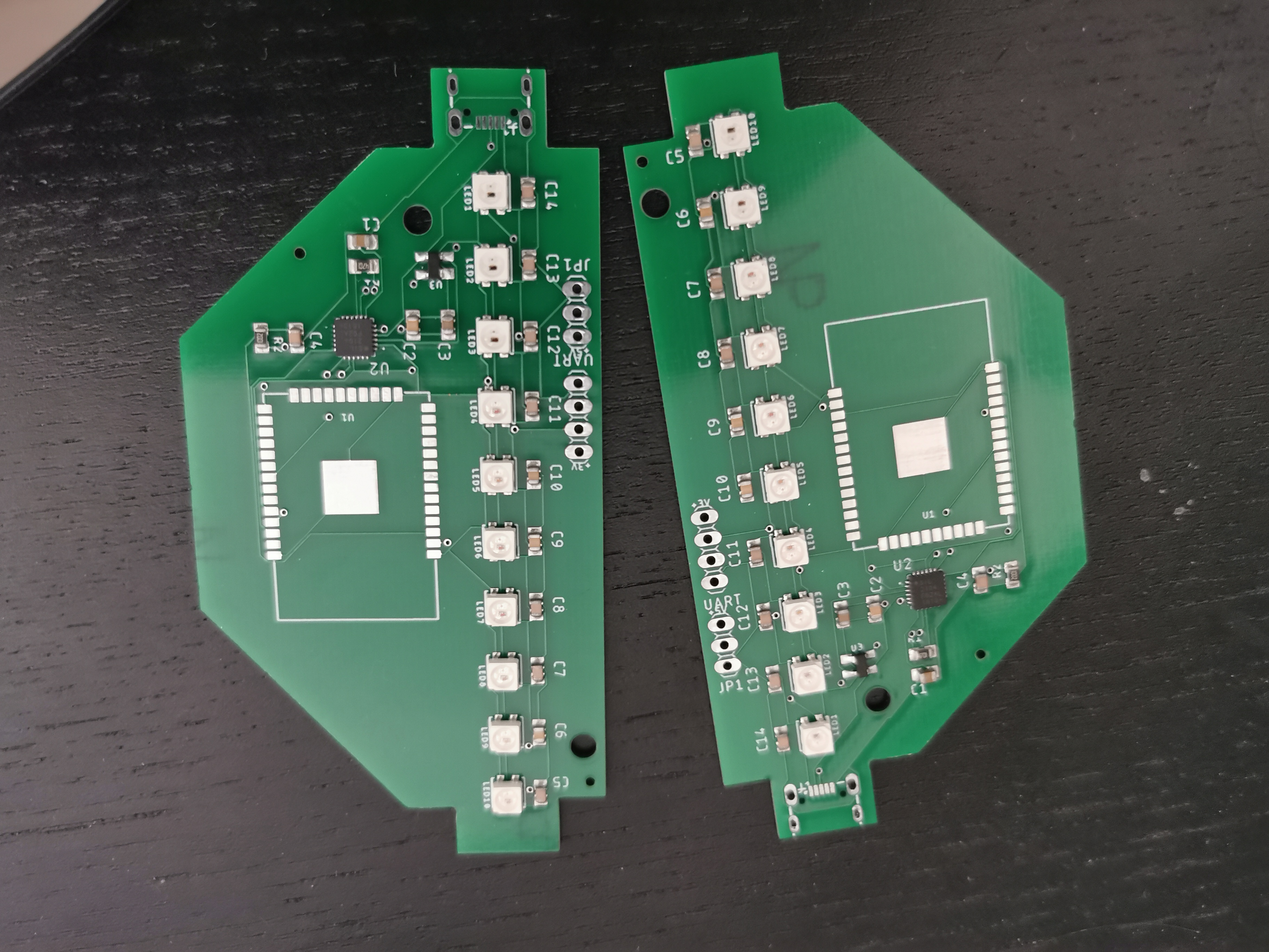 A pictures of two SMT-manufactured Acrylic lamp boards side-by-side.  These were unusable.